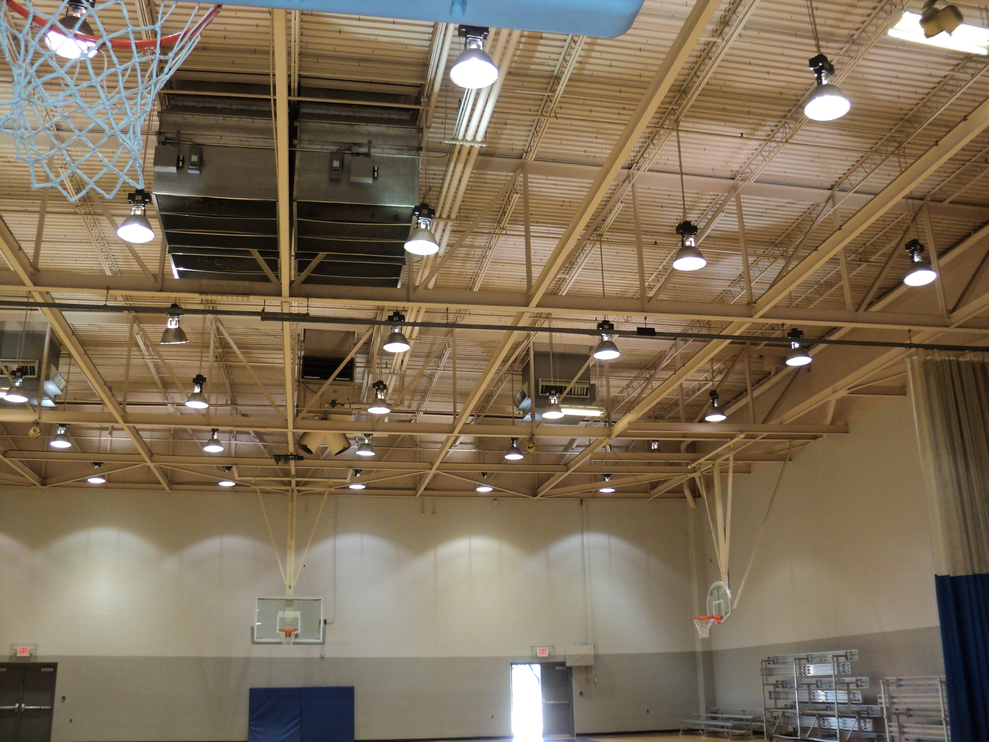 Picture of existing gymnasium roof system consisting of a long span fabricated truss and roof joists.